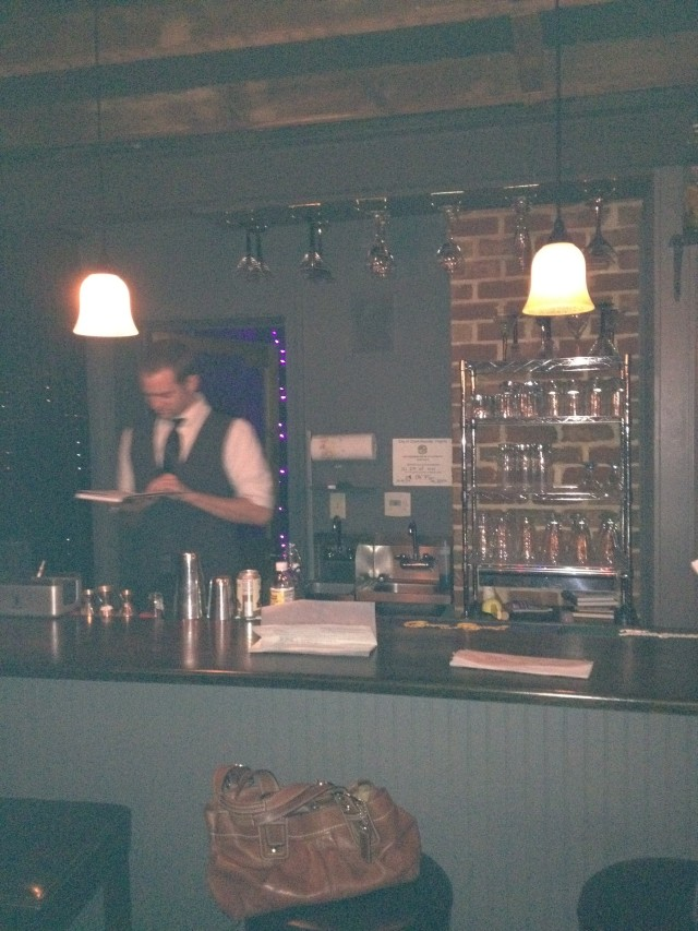 what a fun bar, i love that the bar tenders wear vests
